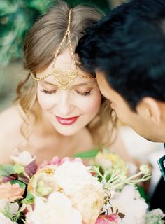 In lieu of a veil, the bride opted for a stunning headpiece.