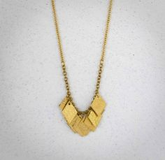 """Dainty brass diamond fringed necklace. Ten vintage brass diamond-shaped charms hang like fringe on brass chain finish with lobster clasp. Great worn alone or layered with other necklaces.  Total necklace length: 59cm (23"""") (shorter or longer lengths are available upon request)  -- vintage b..."""