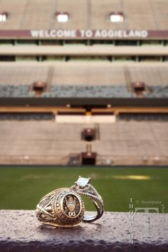Rings at Kyle field :) except it would need his and her Aggie rings with the engagement ring ;)