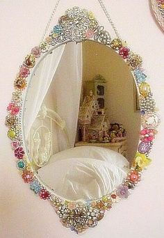 decorative wall mirror jeweled mirror frame embellished with vintage jewelry (sold)