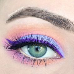 Pastel eye shadow are made more striking by adding a purple winged liner. Lush lashes are added to complete the look. Score the amazing products listed to rock this nigh out ready makeup.
