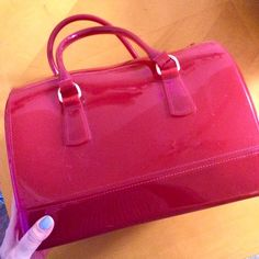 Furla style cherry red plastic duffle candy bag Flexible plastic duffle in the style of Furla's popular candy bag. This bag is bright red with rubber handles and a metal zipper opening. Perfect condition with no flaws. Does not come with dust bag. Bags
