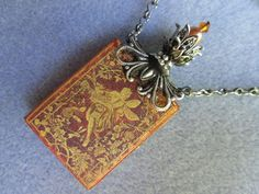 Hey, I found this really awesome Etsy listing at https://www.etsy.com/listing/150596382/fairy-tale-book-necklace-book-club