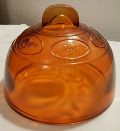 Antique Amber/Orange Glass Cheese Cover Dome Embossed Man Milking Cow VERY UNIQU