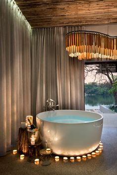 We find that Matetsi Victoria Falls, a luxury Zimbabwe safari lodge, more than delivers on its promise of wildlife viewing and Zambezi scenery. Outdoor Bathrooms, Hotel Bathrooms, Lodge Bathroom, Round Bath, River Lodge, Victoria Falls, Bathroom Inspiration, Lodges, Deco