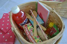 Small individual picnic baskets filled with goodies are also the party favors for this picnic-themed birthday party for girls - Adorable idea!