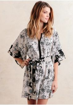 Romantic printed dress featuring gorgeous floral of black, white, lilac, and sky blues hues.
