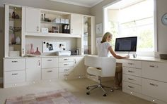 Modern home office designs using white modern office desk combine and imac on top with white office chair and huge window also green wall paint color and catchy carpet on wooden floor.