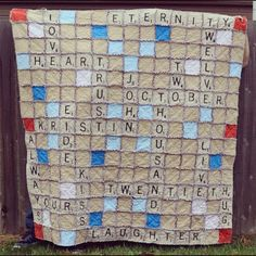 Scrabble Rag Quilt, what a cute idea!! This would be cute to do all the grand kids names for grandma!