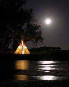 Teepee, full moon, water, tree.