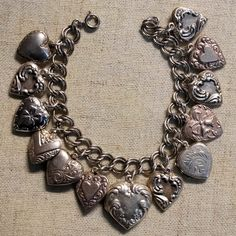 Antique Victorian & Vintage Sterling Puffy Heart Charm Bracelet Heart Lockets. Get the lowest price on Antique Victorian & Vintage Sterling Puffy Heart Charm Bracelet Heart Lockets and other fabulous designer clothing and accessories! Shop Tradesy now