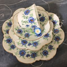 https://www.ebay.co.uk/itm/AYNSLEY-CHINA-FLOWER-HANDLE-QUAD-SET-BLUE-FLOWERS-TEA-CUP-TRIO/142665120737?hash=item213780fbe1:g:2A4AAOSwy~BaM270