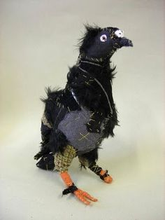 the art room plant: Textile Artist. Poor bedraggled street pigeon. No instructions. This was an art piece.