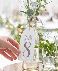 These table number tags would make a lovely addition to your wine bottle table numbers.