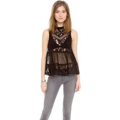 ✨Make me an offer! ✨Free people lace top Black lace top, buttons up the back of the neck (left open in photo) flares at the top of the waist. Free People Tops Blouses