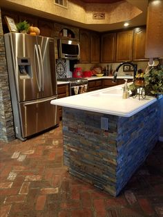 Stone added to island, walls and above new stainless steel microwave Home Remodeling, Microwave, Kitchen Remodel, Outdoor Living, Living Spaces, Home Improvement, Kitchens, Walls, Construction