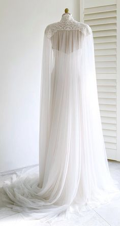 Floor-skimming tulle is adorned with embroidered lace appliqué along the shoulders and high neckline of this romantic long GALINA cape. It is the perfect modern alternative to the traditional veil! Bridal Cape, Bridal Gowns, Embroidered Lace, Lace Applique, Wedding Veil, Wedding Gowns, Bridal Cover Up, Cape Dress, Plus Size Wedding