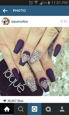 Black matte long nails with heart shape and gems