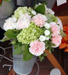 Hand-tied mixed cut flowers, by Caruso & Company