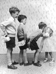 Vintage black and white photo of girl and her gift bearing brothers #cute #children #kiss #family