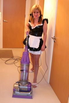 Female Sissy Maid enjoying her work.