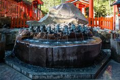 Dragon Purification Fountain - At Motohakone we walked to Hakone Jinja and Hakone Torii where we climbed several flights of stairs (reminded me a bit of Kung Fu Panda) and had a look at the huge cedar trees, temple and dragon fountains.