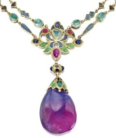 Detail: Art Nouveau necklace by Louis Comfort Tiffany of Tiffany & Co., circa 1914-1927. It features a double-chain of small fancy-shaped links applied with champlevé enamel in shades of blue, green and plum, spaced at intervals by cabochon emeralds. The center of the chain is decorated with a large floral link enameled in blue and green and set with cabochon sapphires, rubies, and an emerald.The chain supports an unusual blue and plum colored sapphire drop. Via Diamonds in the Library.