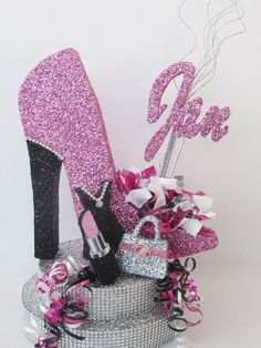 "This centerpiece includes: High Heel Shoe - 13.5"" x 11"" 2 tier base with rhinestone wrap - bottom of base - 12"" round approx. height to the top of the shoe 18"""
