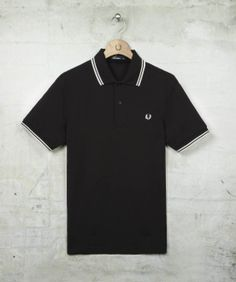 http://www.fredperry.com/men/the-fred-perry-shirt/twin-tipped-fred-perry-shirt-m1200.html#524   Colour 524: Black/Porcelain/Porcelain  size: s.  nice polo for interviews/work