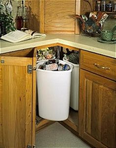 This site is awesome, it has really intuitive cabinets for all those awkward spaces, here's a revolving recycle station for corner spaces
