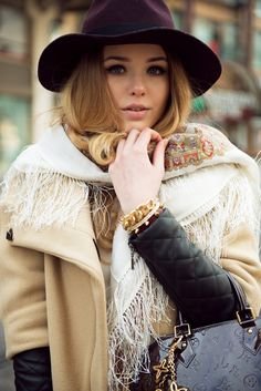 Kristina Bazan beautifully accessorized carrying a Louis Vuitton handbag.