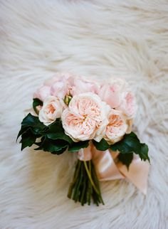 pink garden rose bouquet, photo by Christina McNeill http://ruffledblog.com/industrial-san-francisco-wedding #flowers #gardenrose #bouquets