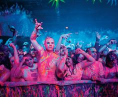 """Dayglow blasts of fluorescent paint rained down on crowds in downtown Austin. Black light made them shine. """"If you weren't dancing, you were just standing there covered in paint."""" Just studying light design..."""