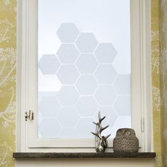 Simple hexagonal windowfilm stickers with a delicate geometric pattern. Adds design detail to your window allowing a diffused light to...