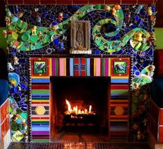 "By mosaic artists Beserra-Byrd. ""We built the fireplace as our portrait,"" adds Beserra, who in 1997 bought the three-bedroom Silver Lake home with Byrd, his partner of 28 years. Mosaic Art, Mosaic Glass, Mosaic Tiles, Stained Glass, Glass Art, Mosaic Backsplash, Mosaic Fireplace, Fireplace Redo, Fireplace Screens"