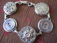 Antique BUTTON bracelet with ornate silver buttons and gray/purple mother of pearl buttons.