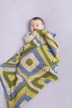 This cozy granny square afghan made with LB Collection Cotton Bamboo is perfect for summer babies.