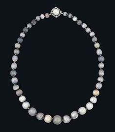 A RARE 19TH CENTURY NATURAL COLOURED PEARL NECKLACE. The graduated row of 44 natural coloured pearls in varying tones of black, grey and bronze, to the similarly-set pearl clasp with old-cut diamond surround, mounted in silver and gold. Provenance: Formerly in the possession of Queen Isabella II of Spain.
