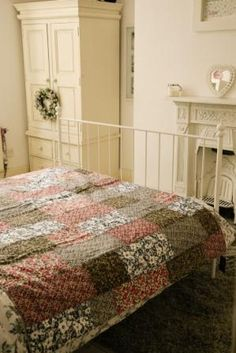 Five Liberty of London prints make up this quilt, stitiched in a traditional 'strip' design.