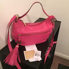 Michael Kors Charm Tassel Bag Fuchsia/pink, excellent condition, small faded spot on bag Michael Kors Bags Crossbody Bags
