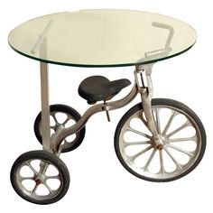 This tricycle was made of cast aluminum in the late 1940s or early 1950s. Designer Denis Ferentinos added an aluminum support and a thick glass top and came up with a table that can definitely be referred to as unique.This item can be purchased on ecofirstart.com