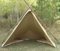 The Woodsman Tarp Tent can be pitched in numerous ways.   Any rectangular tarp can be folded and set into this half pyramid.  Note: The front does close.  The door panels are tied back in this photo.