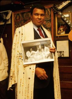 Ali with his robe that Elvis had made for him.