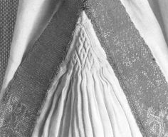 This is from an excellent blog and the photo shows smocking of a gore on a 12th century alb.