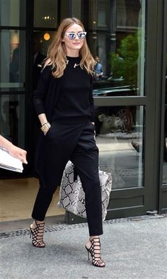 Stylish Olivia Palermo opted for all black in New York City on June 3, 2015. The socialite jazzed up the monochromatic look with a snakeskin bag and white cat-eye sunglasses.