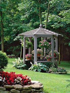 Backyard Ideas.... looooove the gazebo and all the pots of flowers sitting inside!!!!!