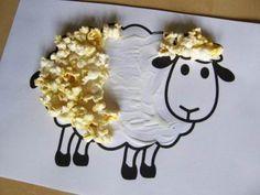 Kudrnatý beránek polepený popcornem.