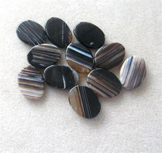 Agate Gemstone Pendants, Jewelry Making Beads, Oval Pendants, Agate Pendants, Craft Supplies, Bead Supply, Jewelry Design Pendant Beads, Black Brown Oval Agate Pendants (1)   This listing features a striped black/brown agate oval gemstone pendant. It is a beautiful pendant with a good black, brown and white color, smooth finish and interesting patterns on each bead. They will look great in any necklace design and measures 20 x 30mm. They have a good polish and are center drilled top to…
