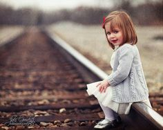 Such an adorable picture.  Too bad railroads scare me....