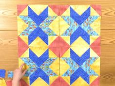 #QuiltmakerMagazine Lessons in Creativity - 404 'Design Options for Block Y' - Go completely off pattern by only using one of the two blocks from Star Crossed Paths, Block Y. Jenny changed the colors and used a fun fish patterned fabric with a bubble print, a tone-on-tone yellow, and a red gingham style print to give the block a new look.